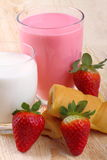 Breakfast with milk, strawberry smoothie and afternoon snack Stock Photography