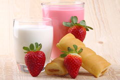 Breakfast with milk, strawberry smoothie and afternoon snack Stock Images
