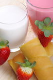 Breakfast with milk, strawberry smoothie and afternoon snack Royalty Free Stock Photos