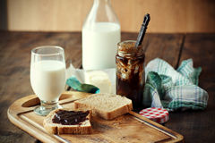 Breakfast. With milk, whole grain bread, butter and jam Royalty Free Stock Photo