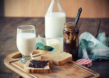 Breakfast. With milk, whole grain rolls, butter and jam Royalty Free Stock Photography