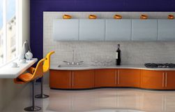 Breakfast in modern kitchen. Modern kitchen with orange and blue cabinets Royalty Free Stock Images
