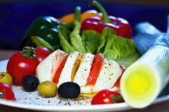 Breakfast with mozzarella and vegetables. Breakfast not only had their fill, but please the eyes their color. Mozzarella with tomatoes and olives Barracuda Stock Images