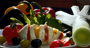 Breakfast with mozzarella and vegetables. Breakfast not only had their fill, but please the eyes their color. Mozzarella with tomatoes and olives Barracuda Royalty Free Stock Photo