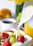 Breakfast Muesli, Black Coffee And Orange Juice. Breakfast muesli, black coffe and orange juice on the side royalty free stock image