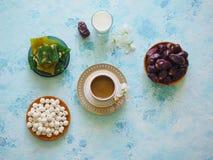 Breakfast with muesli on turquoise background. Muesli with Turkish sweets, kiwi, dates and milk. Breakfast with muesli on blue background. Muesli with Turkish royalty free stock photography