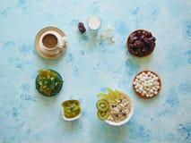 Breakfast with muesli on turquoise background. Muesli with Turkish sweets, kiwi, dates and milk. Breakfast with muesli on blue background. Muesli with Turkish stock image