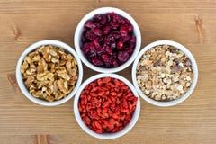 Breakfast muesli, goji berries, walnuts, berries Royalty Free Stock Photo