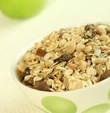 Breakfast, muesli and green apple Stock Photos