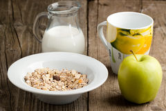 Breakfast with muesli, milk and apple Stock Photos