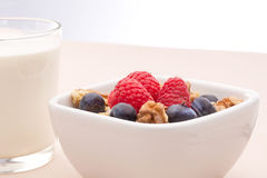 Breakfast of muesli with milk and berries Stock Photo