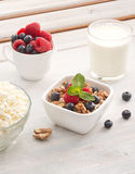 Breakfast of muesli with milk and berries Royalty Free Stock Images