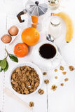 Breakfast with muesli over white wooden background Royalty Free Stock Photos