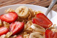 Breakfast muesli with strawberries and banana closeup horizontal Royalty Free Stock Image