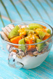 Breakfast with muesli, yoghurt, tropical fruits Royalty Free Stock Images