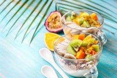 Breakfast with muesli, yoghurt, tropical fruits Stock Photo
