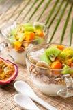 Breakfast with muesli, yoghurt, tropical fruits Royalty Free Stock Photos