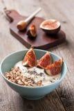 Breakfast with muesli, yogurt, figs Royalty Free Stock Image