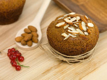Breakfast muffin with almonds and redcurrants Royalty Free Stock Images
