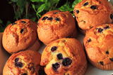 Muffins. Blueberry Muffins on background with green leaves stock images