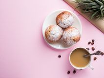 Breakfast muffins coffee milk jug on a pink background. Top view Flat lay royalty free stock photography