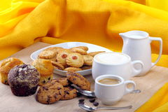 Breakfast with muffins, cookies and milk and coffee Stock Photography