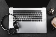 Breakfast for a music fan, modern computer keyboard, top view.  royalty free stock photography