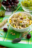 Breakfast with musli and grapes. Bowl of healthy musli with nuts and grapes, healthy and rich breakfast stock photography