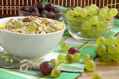 Breakfast with musli and grapes. Bowl of healthy musli with nuts and grapes, healthy and rich breakfast Stock Photos