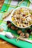 Breakfast with musli and grapes. Bowl of healthy musli with nuts and grapes, healthy and rich breakfast Royalty Free Stock Photo
