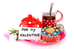 Breakfast for my Valentine; cup of tea and cupcake Stock Photography