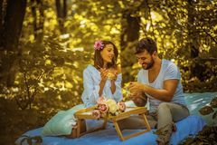 Breakfast at nature . Young happy couple. royalty free stock photos