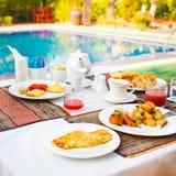 Breakfast near a swimming pool Stock Photo
