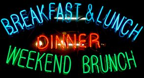 Breakfast Neon Sign. Neon sign in a restaurant window advertising breakfast, lunch, dinner, and weekend brunch Stock Photography