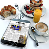Breakfast and news Royalty Free Stock Photos