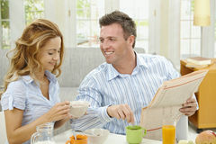 Breakfast and newspaper Stock Photos