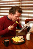 Breakfast and Newspaper Royalty Free Stock Image