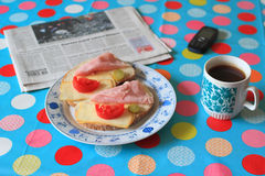 Breakfast and newspaper on table stock photography