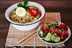 Noodles with sauce. Breakfast, noodles, lunch, food, food, sauce, carbohydrates, lunch, dinner, rustic stylein a plate of noodles with a tomato sauce, Chinese Stock Image