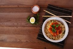 Noodles with sauce. Breakfast, noodles, lunch, food, food, sauce, carbohydrates, lunch, dinner, rustic stylein a plate of noodles with a tomato sauce, Chinese Royalty Free Stock Photography