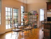 Breakfast nook. Dining area metal and glass table Stock Photos