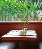 Breakfast nook. Light and airy breakfast nook; place setting with rose stock images