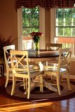 Breakfast nook lit by the setting sun royalty free stock photography