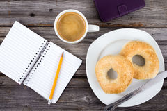 Breakfast and note book Royalty Free Stock Images