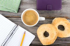 Breakfast and note book Royalty Free Stock Photos