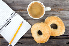 Breakfast and note book Royalty Free Stock Image