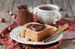 Breakfast with nutella. And tea, selective focus Royalty Free Stock Image