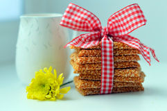 Breakfast. Nuts-and-honey bars , a milk and a flower Stock Photography