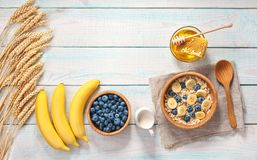 Breakfast with oat flakes, natural milk, fresh banana, almonds a Stock Image