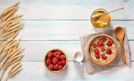 Healthy breakfast with oat flakes, natural milk, fresh strawberr Royalty Free Stock Image